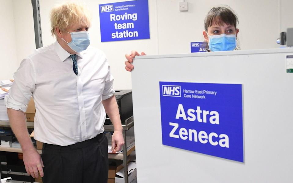 Boris Johnson sees the operation for distributing Oxford/Astrazaneca vaccine in London during a visit to a vaccination centre in the north of the capital - Stefan Rousseau/PA