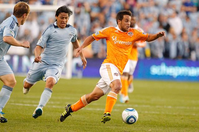 KANSAS CITY, KS - NOVEMBER 06: Danny Cruz #05 of the Houston Dynamo pushes the ball up the field in the first half during the MLS Eastern Conference Championship match at Livestrong Sporting Park on November 06, 2011 in Kansas City, Kansas. (Photo by Kyle Rivas/Getty Images)