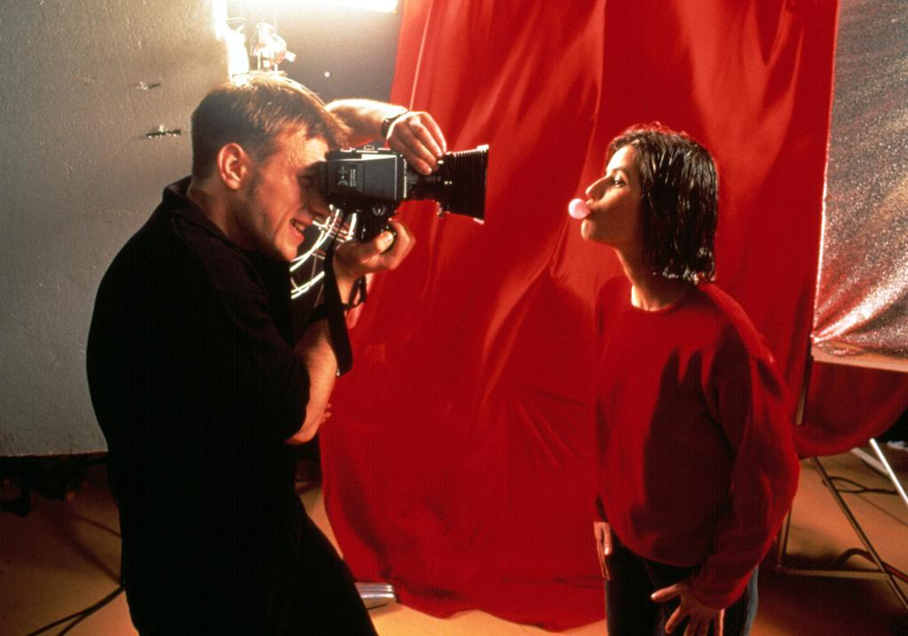 """<a href=""""http://movies.yahoo.com/movie/1800229767/info"""">RED</a> (Trois couleurs: Rouge) <br>Directed by: <span>Krzysztof Kieslowski</span> <br>Starring: <span>Irene Jacob</span>, <span>Jean-Louis Trintignant </span>"""