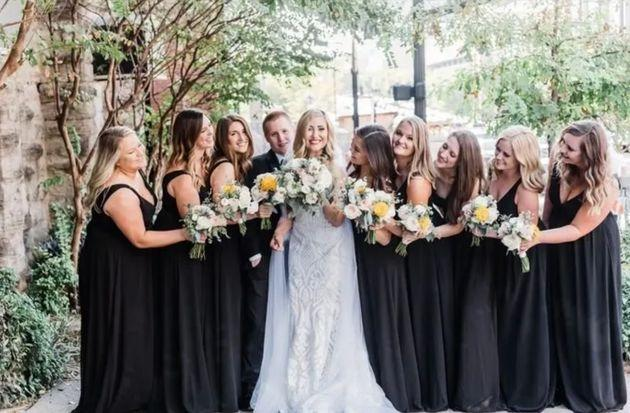 The bridal party entered the reception to the