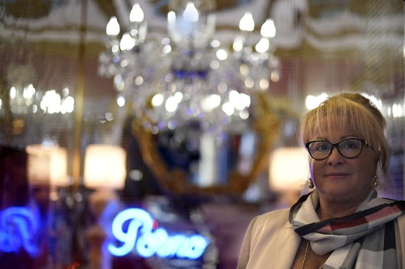 Bagdad nightclub owner Juani De Lucia pictured at the entrance of her club in Barcelona (AFP Photo/GABRIEL BOUYS)