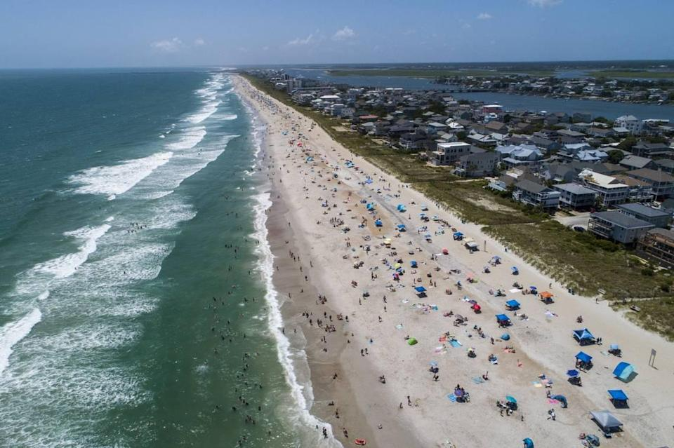 Many beach towns charge for public parking to alleviate some of the financial burden of the taxpayers to maintain town infrastructure and property. On New Hanover'sHarbor Island, Wrightsville Beach implemented paid parking for similar reasons. The town is expected to receive $4 million in revenuefrom about 1,600 parking spaces.