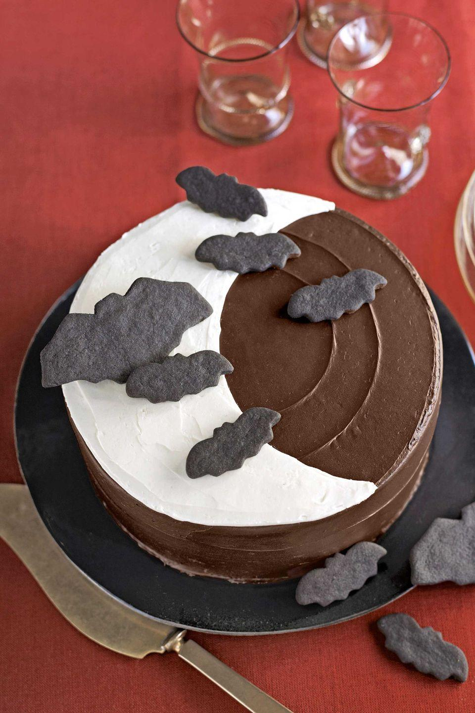 """<p>A simple chocolate cake gets added snack appeal from bat-shaped sugar cookies.</p><p><strong><a href=""""https://www.countryliving.com/food-drinks/recipes/a3013/over-the-moon-cake-recipe/"""" rel=""""nofollow noopener"""" target=""""_blank"""" data-ylk=""""slk:Get the recipe"""" class=""""link rapid-noclick-resp"""">Get the recipe</a>.</strong> </p>"""
