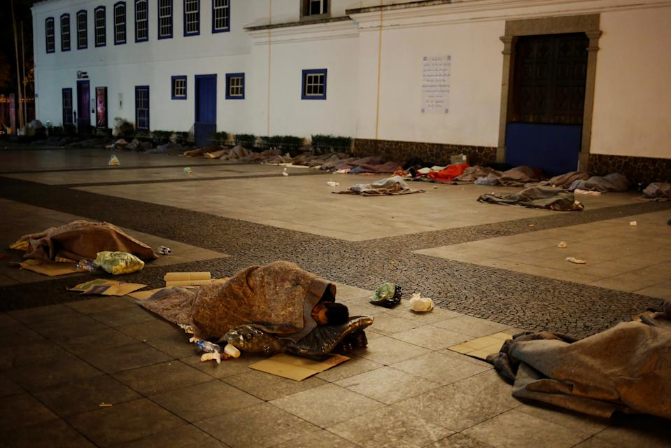 Homeless people covered in blankets sleep on the street, on a cold night in Sao Paulo, Brazil, June 12, 2016. REUTERS/Nacho Doce