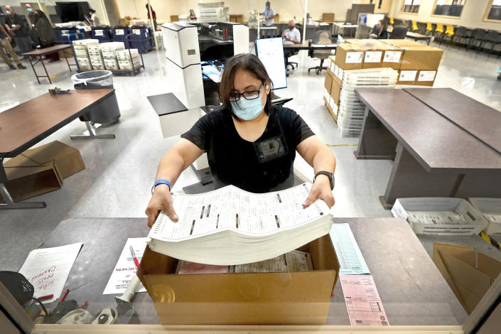 Image: An election official counts ballots inside the Maricopa County Recorder's Office in Phoenix (Matt York / AP file)
