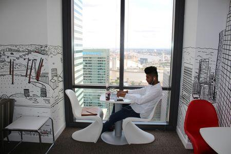 A man uses a laptop in the Level39 FinTech hub based in the One Canada Square tower of the Canary Wharf district of London