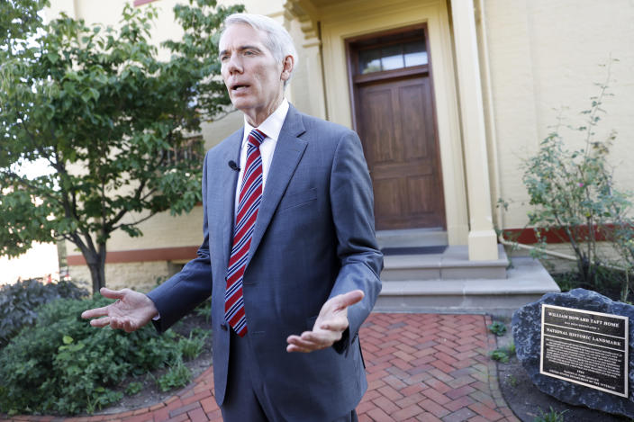 """Sen. Rob Portman, R-Ohio, is interviewed outside the William Howard Taft National Historic Site, Friday, Sept. 14, 2018, in Cincinnati. Portman, who's been a strong advocate for Supreme nominee Brett Kavanaugh, remains confident he will be confirmed after a """"way too partisan"""" battle in Washington. (AP Photo/John Minchillo)"""