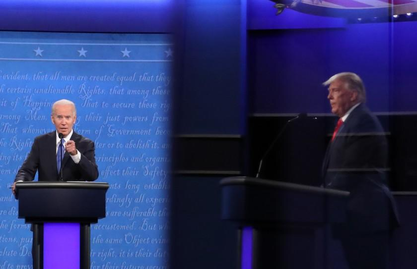 NASHVILLE, TENNESSEE - OCTOBER 22: Democratic presidential nominee Joe Biden speaks as U.S. President Donald Trump is shown in a reflection listening in the final presidential debate at Belmont University on October 22, 2020 in Nashville, Tennessee. This is the last debate between the two candidates before the election on November 3. (Photo by Chip Somodevilla/Getty Images)