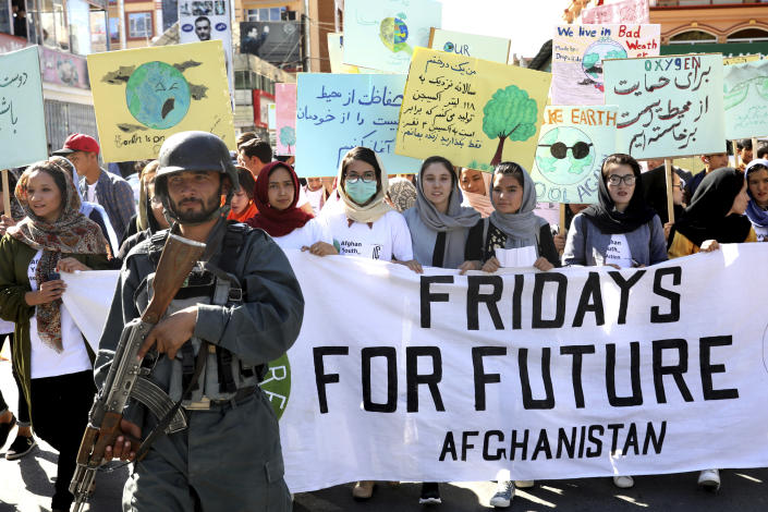 young people attend a Climate Strike rally, as Afghan security forces guard them in Kabul, Afghanistan, Friday, Sept. 20, 2019.In the Afghan capital Kabul, where people are dying every day in horrific bomb attacks, a young generation, worried that if war doesn't kill them climate change will, took part in the global climate strike. (Photo: Ebrahim Noroozi/AP)