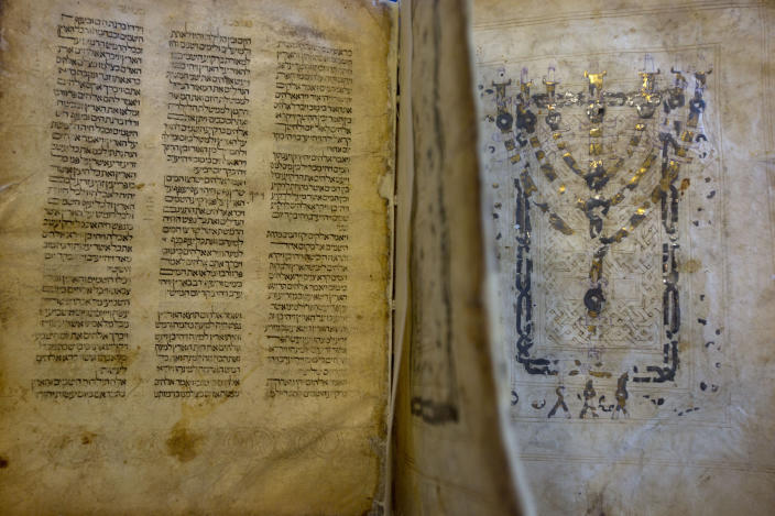 """This photo taken Sunday, Oct. 5, 2014 shows a Jewish manuscript smuggled into Israel from Damascus in a Mossad spy operation in the early 1990s, in Jerusalem. The manuscript is one of the earliest existing complete manuscripts of the Hebrew bible. The Jerusalem District Court ruled Monday, Aug. 17, 2020 that the books were """"treasures of the Jewish people"""" that had """"historic, religious and national importance"""" and must be preserved. It determined that the best way to do so would be to keep them at the National Library under a public trust. (AP Photo/Sebastian Scheiner)"""