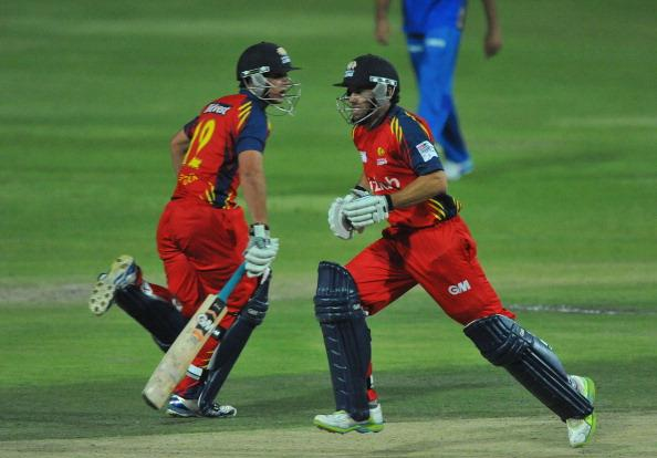 JOHANNESBURG, SOUTH AFRICA - OCTOBER 14:  Neil McKenzie (R) and Quinton de Kock of the Lions run between the wickets during the Karbonn Smart CLT20 match between Highveld Lions and Mumbai Indians at Bidvest Wanderers Stadium on October 14, 2012 in Johannesburg, South Africa.  (Photo by Duif du Toit/Gallo Images/Getty Images)