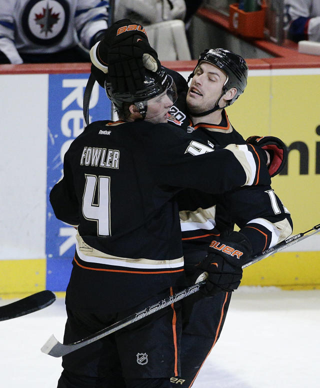 Anaheim Ducks' Cam Fowler, left, and Ryan Getzlaf celebrate a goal by Fowler during the first period of an NHL hockey game against the Winnipeg Jets, Tuesday, Jan. 21, 2014, in Anaheim, Calif. (AP Photo/Jae C. Hong)
