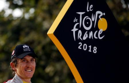 FILE PHOTO: Cycling - Tour de France - The 116-km Stage 21 from Houilles to Paris Champs-Elysees - July 29, 2018 - Team Sky rider Geraint Thomas of Britain celebrates his overall victory on the podium. REUTERS/Stephane Mahe