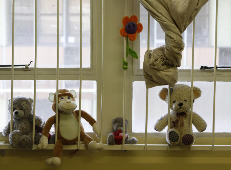 Soft toys are placed on a windowsill at the Teddy Bear Clinic, where abused children are treated, in Johannesburg, Friday, Feb. 8, 2013. In a country where one in four women are raped and where months-old babies and 94-year-old grandmothers are sexually assaulted, citizens are demanding action after a teenager was gang-raped, sliced open from her stomach to her genitals, and left for dead on a construction site last week. (AP Photo/Denis Farrell)