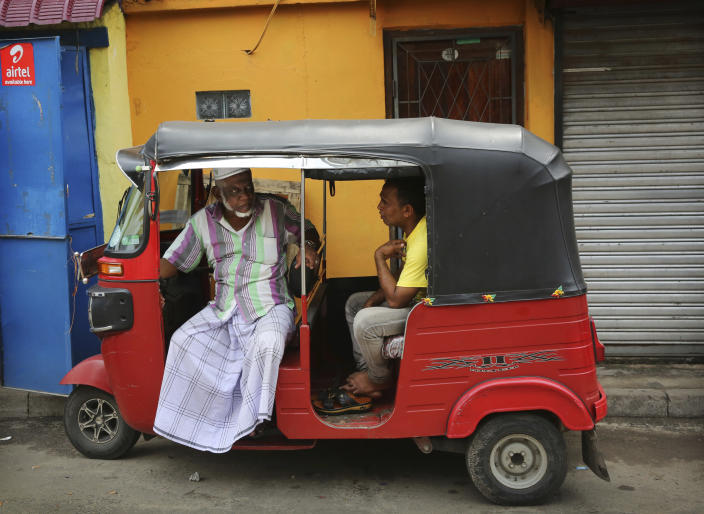 """Sri Lankan Muslims talk sitting inside a three-wheeler in Colombo, Sri Lanka, Monday, April 29, 2019. The Catholic Church in Sri Lanka said Monday that the government should crack down on Islamic extremists with more vigor """"as if on war footing"""" in the aftermath of the Easter bombings. Meanwhile, the government has banned all kinds of face coverings that may conceal people's identities. The emergency law, which took effect Monday, prevents Muslim women from veiling their faces. (AP Photo/Manish Swarup)"""
