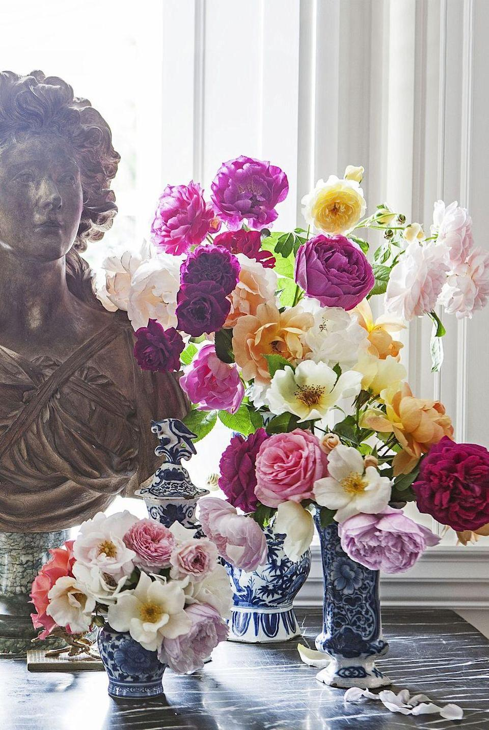 """<p>Groupings of nosegays can be more romantic than one big vase full. Designer and gardener <a href=""""https://www.housebeautiful.com/entertaining/flower-arrangements/tips/g3378/carolyne-roehm-flower-arranging-tips/"""" rel=""""nofollow noopener"""" target=""""_blank"""" data-ylk=""""slk:Carolyne Roehm"""" class=""""link rapid-noclick-resp"""">Carolyne Roehm</a> recommends arranging them naturally, like the blooms just came from the garden.</p><p><strong><em>Frontgate Blue Ming Vase Collection, $59</em></strong> <a class=""""link rapid-noclick-resp"""" href=""""https://go.redirectingat.com?id=74968X1596630&url=https%3A%2F%2Fwww.frontgate.com%2Fblue-ming-small-ceramic-collection%2F749307&sref=https%3A%2F%2Fwww.housebeautiful.com%2Fentertaining%2Fflower-arrangements%2Fg19409803%2Feaster-flower-arrangements%2F"""" rel=""""nofollow noopener"""" target=""""_blank"""" data-ylk=""""slk:BUY NOW"""">BUY NOW</a></p>"""