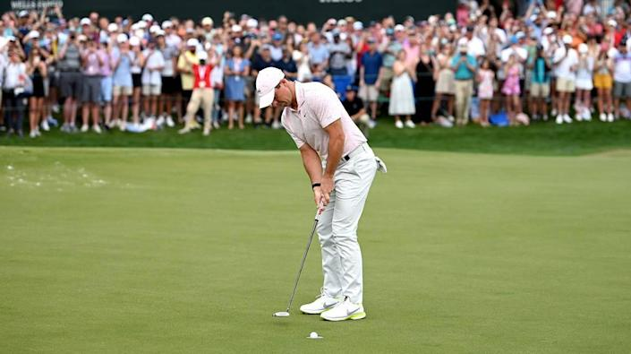 Golfer Rory McIlroy sinks the winning putt on the 18th green during final round action of the Wells Fargo Championship at Quail Hollow Club in Charlotte, NC on Sunday, May 9, 2021. McIlroy scored a 68 on the round and finished at -10.