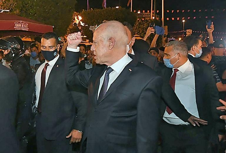 President Saied gestures in Tunis's central Habib Bourguiba Avenue after he ousted the premier and ordered parliament closed