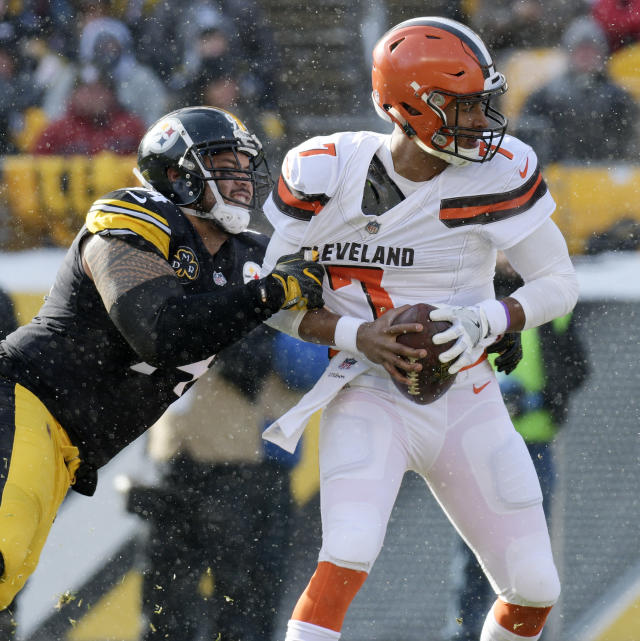 <p>Cleveland Browns quarterback DeShone Kizer (7) is sacked by Pittsburgh Steelers defensive end Tyson Alualu (94) during the first half of an NFL football game in Pittsburgh, Sunday, Dec. 31, 2017. (AP Photo/Don Wright) </p>