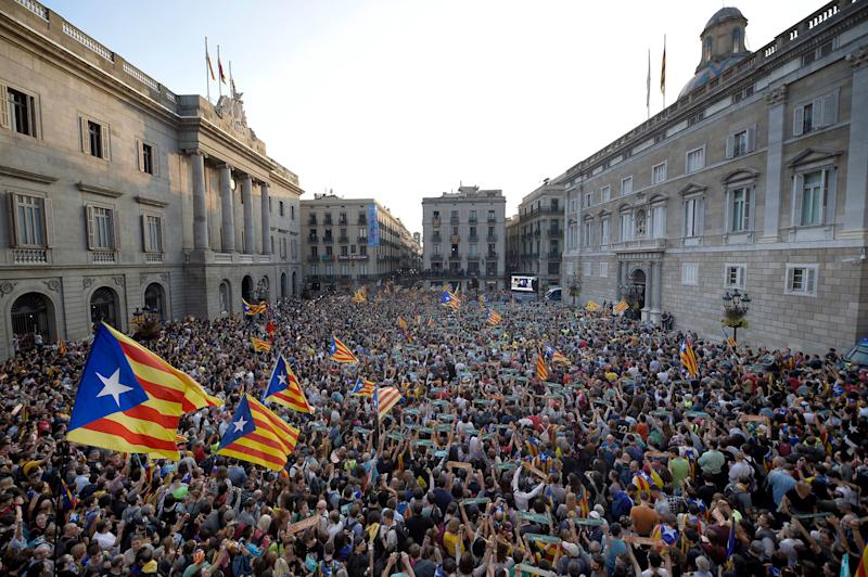 People gather to celebrate at Sant Jaume Square in Barcelona.