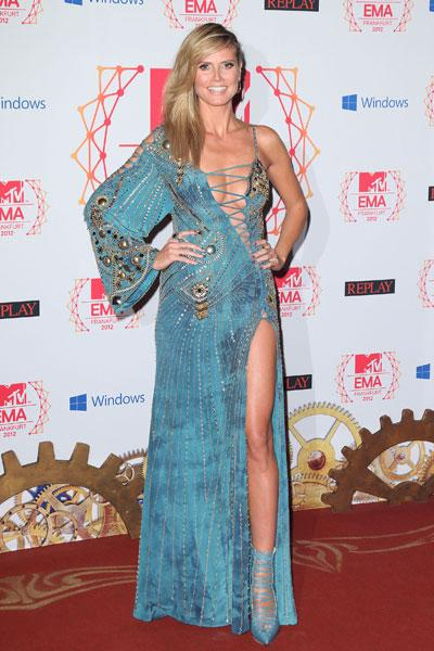 Heidi Klum: Maybe Heidi was in the same Vegas show as her fellow model Isabeli Fontana. The gawdy seafoam blue dress shows off too much of the model's assets. From the barely held-together top to the thigh-high slit: We get it, Heidi, you're a hot model but you don't need to shove it in our faces! (Photo by Mike Marsland/WireImage)