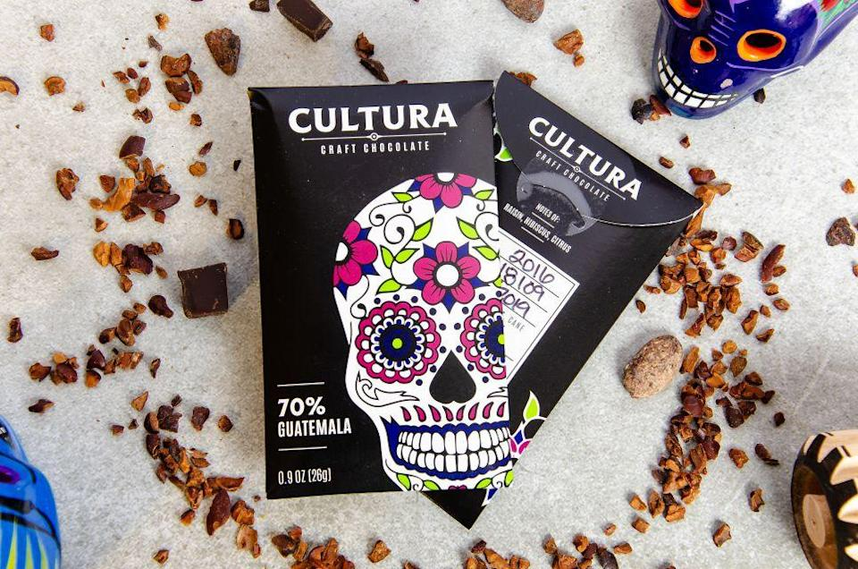 """<p><strong>Cultura Craft Chocolate</strong></p><p>culturachocolate.com</p><p><strong>$5.00</strong></p><p><a href=""""https://www.culturachocolate.com/store/p12/Mini_Chocolate_Bar_%3A_70%25_Guatemala.html"""" rel=""""nofollow noopener"""" target=""""_blank"""" data-ylk=""""slk:BUY NOW"""" class=""""link rapid-noclick-resp"""">BUY NOW</a></p><p>Damaris Ronkanen, founder of Cultura Craft Chocolate, was inspired by her trips to Mexico when she was a kid and seeing her grandmother cook. Passionate about food, Damaris started a career in cooking which eventually led to Cultura Craft Chocolate. You can now shop her chocolates online, from <a href=""""https://www.culturachocolate.com/store/c3/Chocolate_Beverages.html"""" rel=""""nofollow noopener"""" target=""""_blank"""" data-ylk=""""slk:chocolate beverages"""" class=""""link rapid-noclick-resp"""">chocolate beverages</a> to <a href=""""https://www.culturachocolate.com/store/c2/Large_Chocolate_Bars.html"""" rel=""""nofollow noopener"""" target=""""_blank"""" data-ylk=""""slk:chocolate bars"""" class=""""link rapid-noclick-resp"""">chocolate bars</a>, made from cocoa beans from all over Latin America.</p>"""