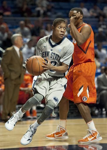 Penn State's Tim Frazier (23) drives past Illinois guard Tracy Abrams during the first half of an NCAA college basketball game in State College, Pa., Thursday, Jan. 19, 2012. (AP Photo/Andy Colwell)