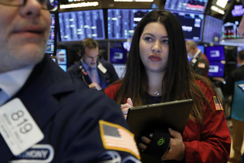 Trader Ashley Lara works on the floor of the New York Stock Exchange, Monday, Jan. 27, 2020. Stock tumbled at the open on Wall Street following a sell-off in markets in Europe and Japan as investors grow more concerned about the potential economic impact of an outbreak of a deadly coronavirus. (AP Photo/Richard Drew)