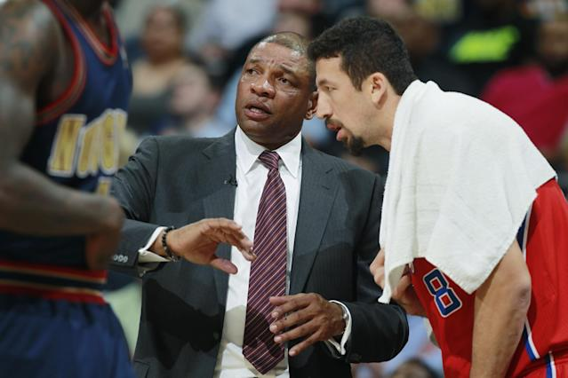 Los Angeles Clippers head coach Doc Rivers, left, confers with forward Hedo Turkoglu, of Turkey, before the player took the court to face the Denver Nuggets in the fourth quarter of the Nuggets' 110-100 victory in an NBA basketball game in Denver on Monday, March 17, 2014. (AP Photo/David Zalubowski)