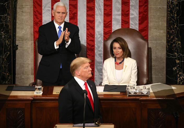 Speaker of the House Nancy Pelosi, D-Calif., alongside Vice President Mike Pence applaud President Trump during his second State of the Union address to a joint session of Congress. (Photo: Leah Mills/Reuters)