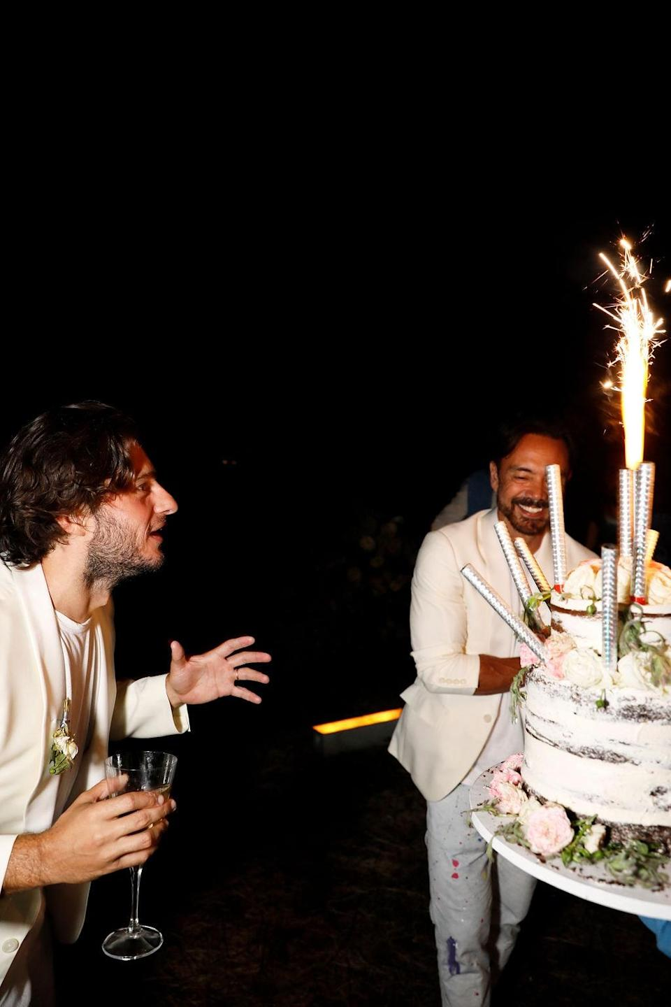 """""""At this point, I think I was so caught up in the moment and enjoying everyone's company, I had forgotten a cake was even a part of the wedding,"""" Nicholas admits. """"So I'm sure this is capturing my genuine surprise and enthusiasm."""""""
