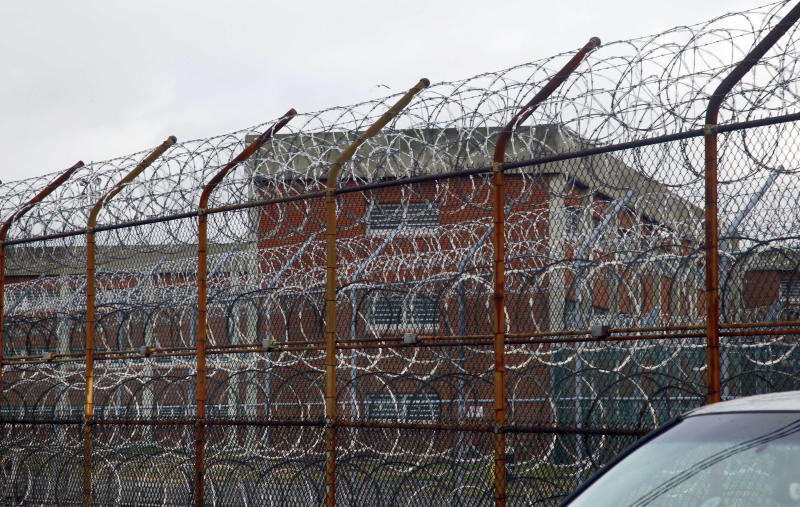FILE - This March 16, 2011 file photo shows a barbed wire fence outside inmate housing on New York's Rikers Island correctional facility in New York. Officials say that for at least a week, former inmate Matthew Matagrano used phony credentials to get into multiple city lockups, including Rikers Island and the Manhattan Detention Center, where he mingled with inmates for hours. (AP Photo/Bebeto Matthews, File)