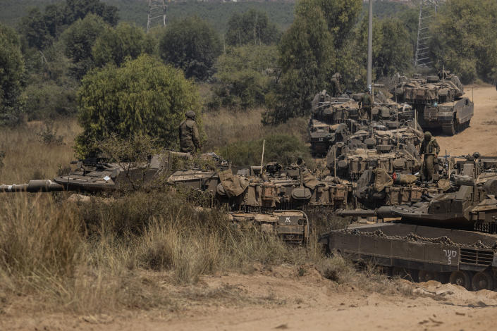 Israeli soldiers with armored vehicles gather in a staging ground near the border with Gaza Strip, southern Israel, May 14, 2021. (AP Photo/Tsafrir Abayov)