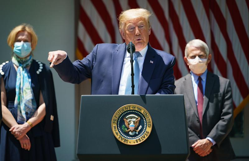 Sixty-nine per cent of Americans do not trust the president to assure them about the efficacy and safety of a coronavirus vaccine (AFP via Getty Images)