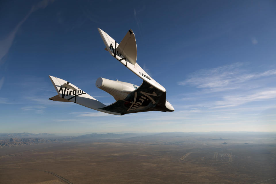 MOJAVE, UNITED STATES - OCTOBER 10: (EDITORIAL USE ONLY, NO SUBJECT SPECIFIC TV BROADCAST DOCUMENTARIES OR BOOK USE) Virgin Galactic vehicle SpaceShipTwo completes it's successful first glide flight at Mojave on October 10, 2010 over Mojave in California. (Photo by Mark Greenberg/Virgin Galactic/Getty Images)