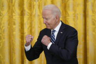 President Joe Biden gestures during a naturalization ceremony in the East Room of the White House, Friday, July 2, 2021, in Washington. (AP Photo/Patrick Semansky)