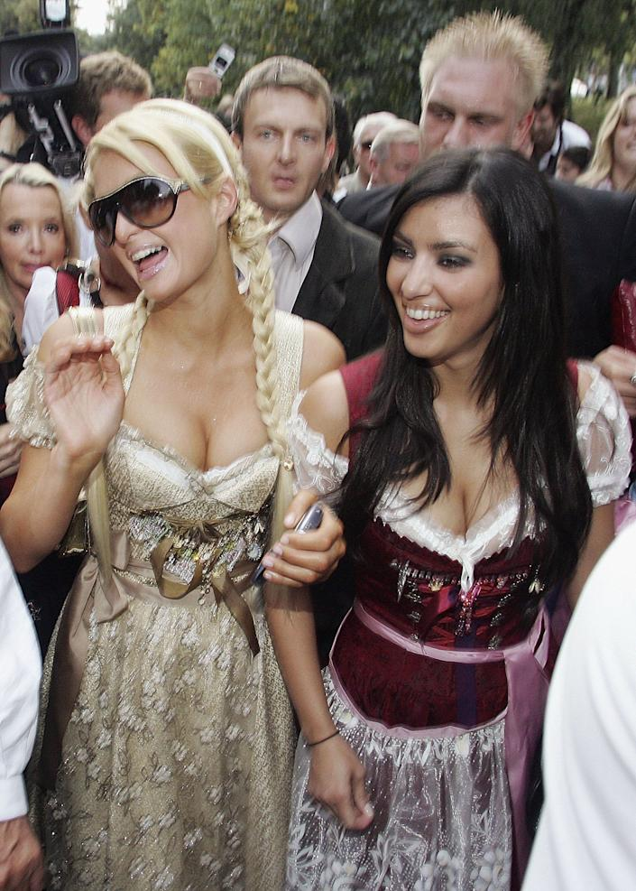 MUNICH, GERMANY - SEPTEMBER 25: Socialite/actress Paris Hilton and her girlfrind Kim Kardashian attend the Octoberfest to promote the new canned sparkling wine 'Rich Prosecco' at the Munich Octoberfest on September 25, 2006 in Munich, Germany. (Photo by Thomas Niedermueller/Getty Images)