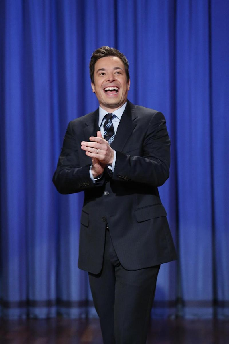 "This April 4, 2013 photo released by NBC shows Jimmy Fallon, host of ""Late Night with Jimmy Fallon,"" in New York. The role of female talk-show hosts in late-night TV network history, all 50-plus years of it, can be summed up in two words: Joan Rivers. It takes just another two _ Arsenio Hall _ to do the same for minorities. There's no indication that's going to change in the latest round of musical chairs involving ""Tonight"" and ""Late Night."" (AP Photo/NBC, Lloyd Bishop)"