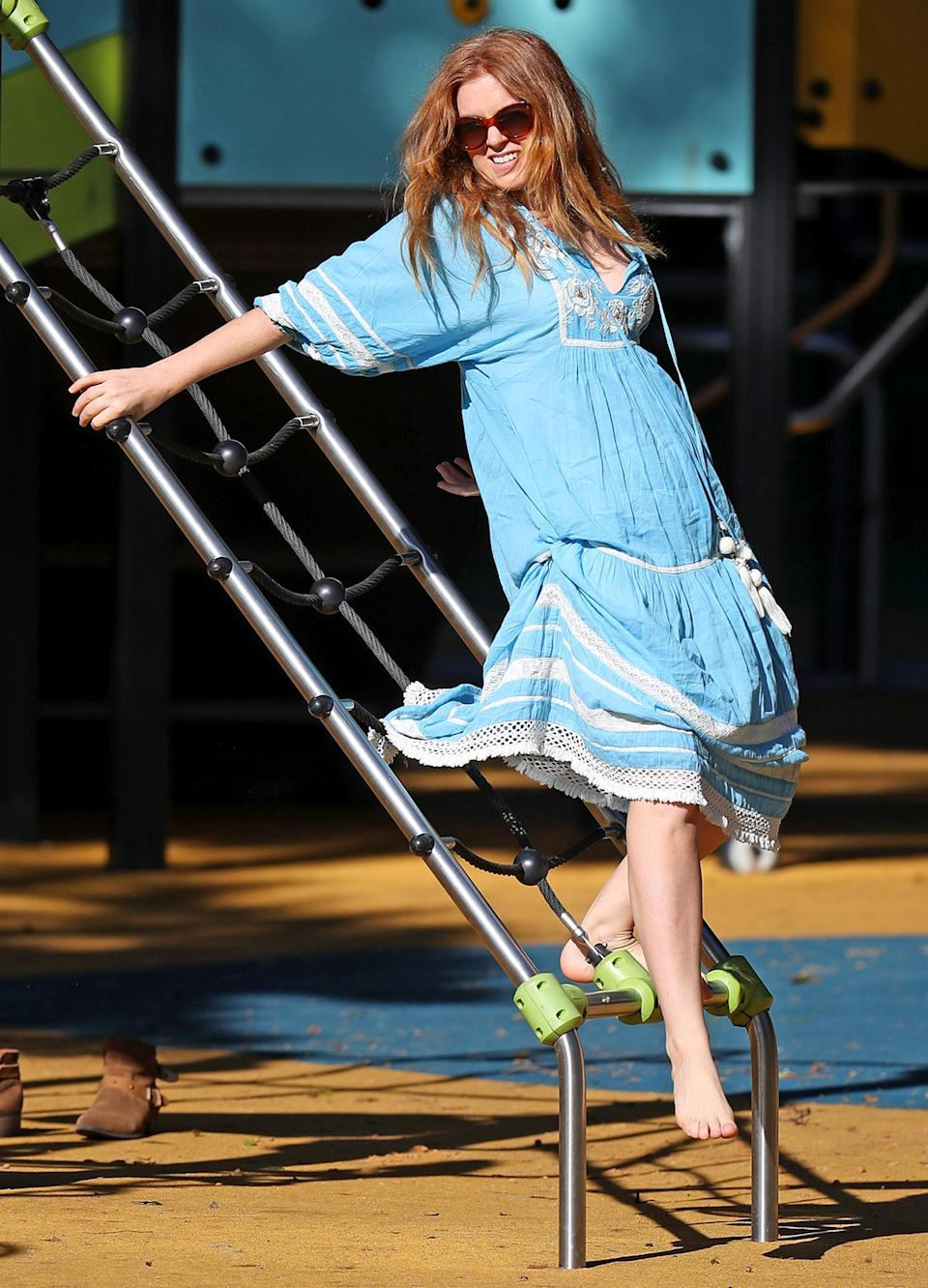 <p>Isla Fisher has a little fun at the local playground in Sydney, Australia on Monday.</p>