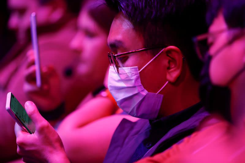 An attendee wears a surgical mask during Samsung Galaxy Unpacked 2020 in San Francisco