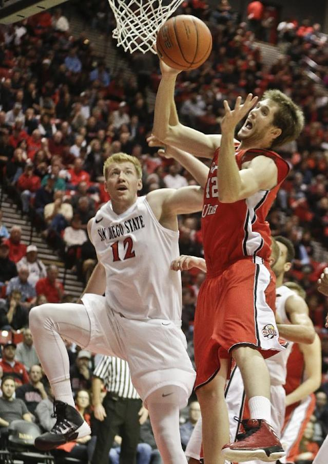 Southern Utah forward Jaren Jeffery pulls down a rebound as San Diego State forward James Johnson watches during the first half of an NCAA college basketball game Wednesday, Dec. 18, 2013, in San Diego. (AP Photo/Lenny Ignelzi)