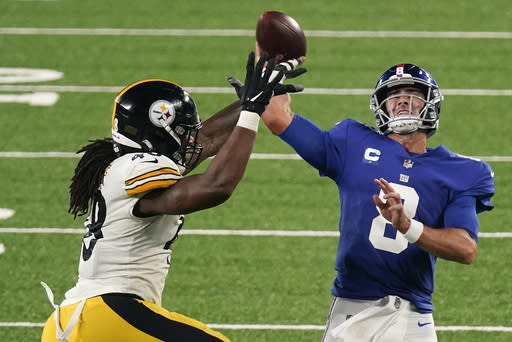 New York Giants quarterback Daniel Jones (8) throws under pressure from Pittsburgh Steelers outside linebacker Bud Dupree (48) during the third quarter of an NFL football game Monday, Sept. 14, 2020, in East Rutherford, N.J. (AP Photo/Seth Wenig)