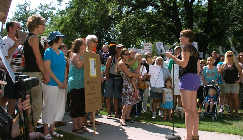 Rally organizer Sheena Rice speaks to protesters gathered on the Yellowstone County Courthouse lawn in Billings, Mont. on Thursday Aug. 29, 2013. Rice called for the resignation of a state judge over comments he made about the teenage victim in a rape case. Judge G. Todd Baugh has apologized for the comments but says he has no intention of resigning. (AP Photo/Matthew Brown)