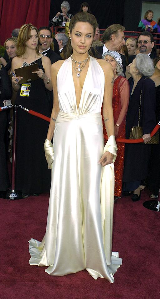 5. 76th Annual Academy Awards (2004)   South African visionary Marc Bouwer designed the plunging silk column gown and matching wrap Angelina donned to the 2004 Oscars. A pulled-back 'do and dripping diamond necklace completed her flawless look.