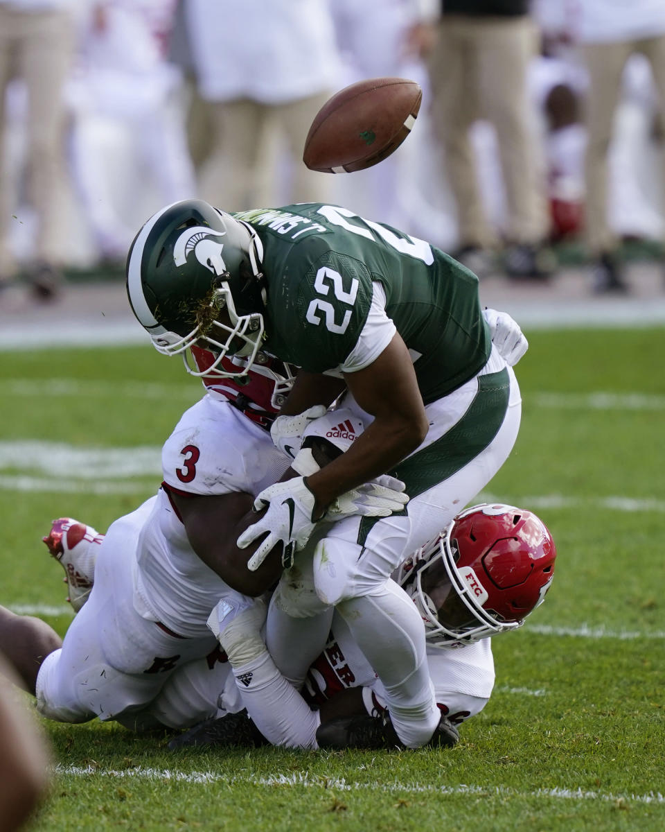 Rutgers linebacker Olakunle Fatukasi (3) knocks the ball away from Michigan State running back Jordan Simmons (22) during the second half of an NCAA college football game, Saturday, Oct. 24, 2020, in East Lansing, Mich. (AP Photo/Carlos Osorio)