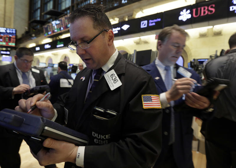 Trader Edward Curran, center, works on the floor of the New York Stock Exchange Monday, March 25, 2013. U.S. stock markets opened higher after Cyprus clinched a last-minute bailout that saved it from bankruptcy. (AP Photo/Richard Drew)