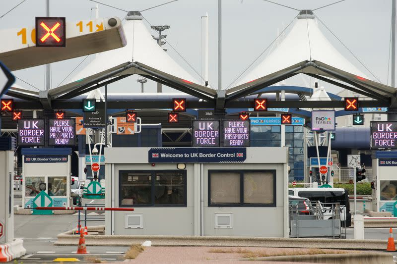 FILE PHOTO: UK border force booths are seen at the terminal ferry in Calais, as the 14-day quarantine for international arrivals was introduced this monday