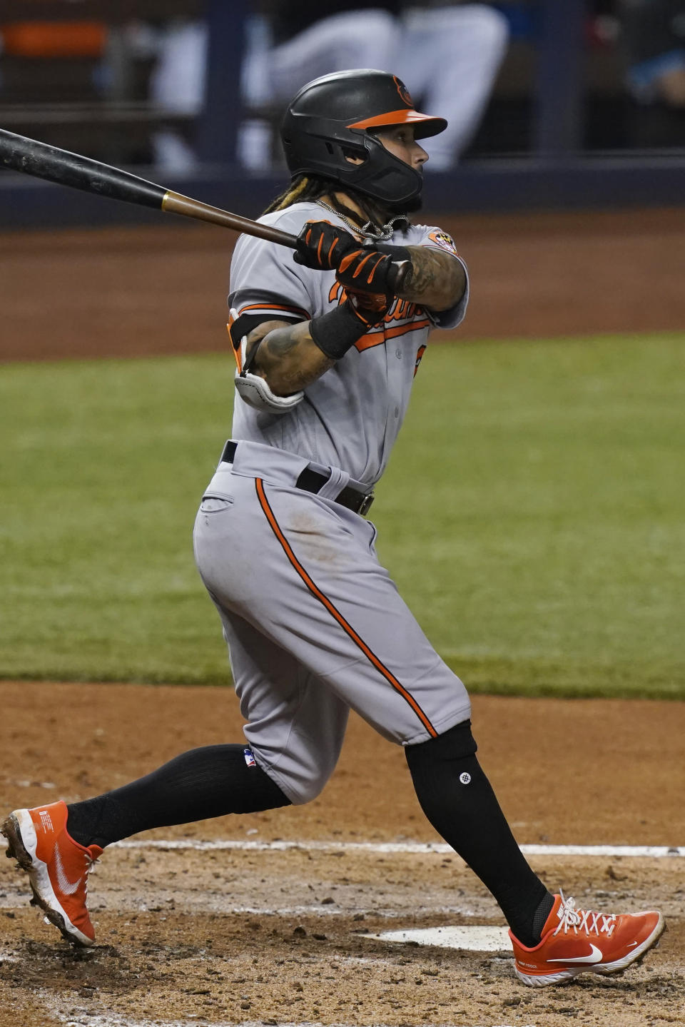 Baltimore Orioles shortstop Freddy Galvis (2) hits a home run during the third inning of a baseball game against the Miami Marlins, Tuesday, April 20, 2021, in Miami. (AP Photo/Marta Lavandier)