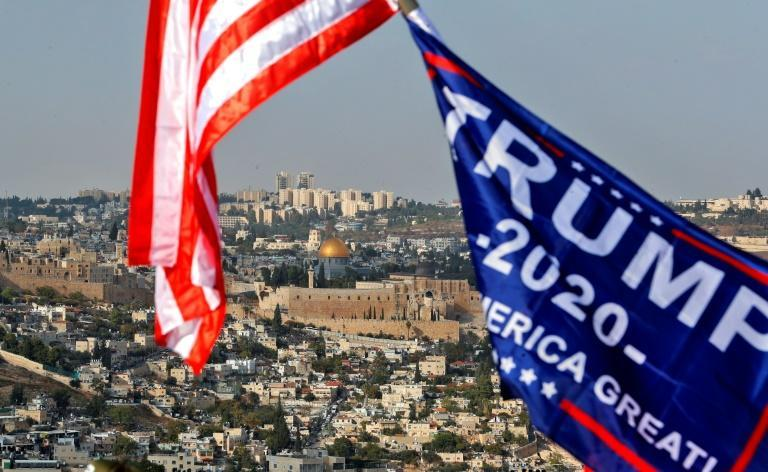 US and Trump campaign flags fly in Jerusalem before the Dome of the Rock within the Aqsa mosque, or Temple Mount, a complex holy to both Muslims and Jews