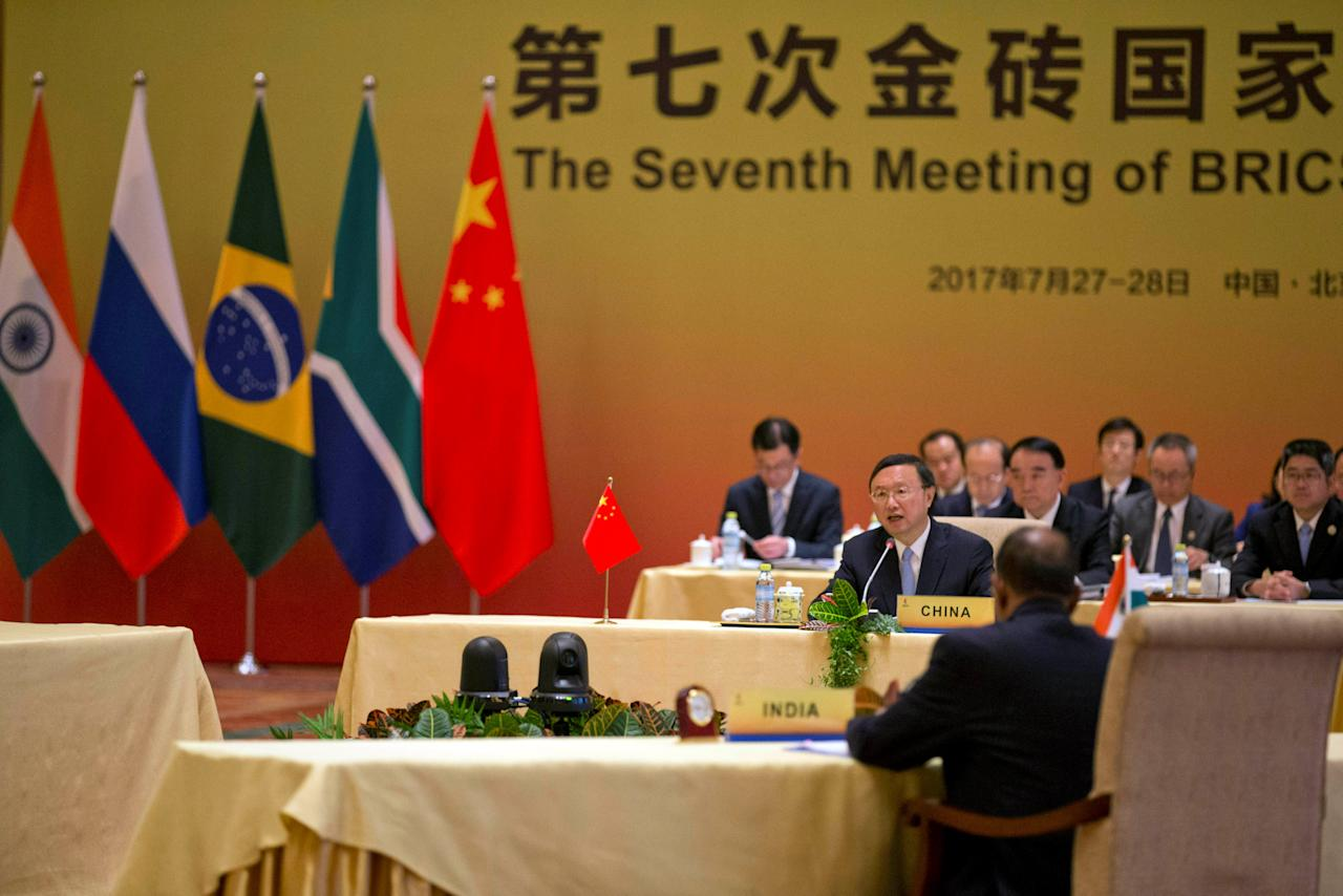 Chinese State Councilor Yang Jiechi, (C) hosts the seventh meeting of BRICS senior representatives on security issues held at the Diaoyutai state guesthouse near Indian National Security Advisor Ajit Doval, (front back to camera) in Beijing, China, Friday, July 28, 2017. REUTERS/Ng Han Guan/Pool